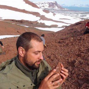 Dr. Grzegorz Niedźwiedzki holding a fragment of rock with Kalaallitkigun jenkinsi's mandible. Credit: Andrzej Wolniewicz